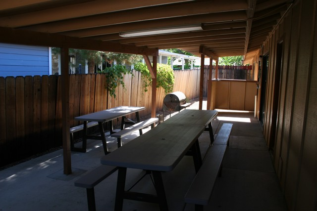Covered patio w/ lots of seating and BBQ